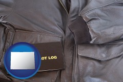 colorado map icon and an leather aviator jacket and pilot log book