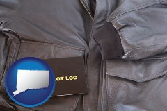 connecticut map icon and an leather aviator jacket and pilot log book