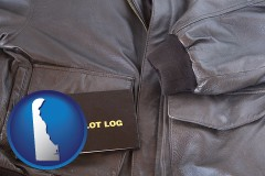 delaware map icon and an leather aviator jacket and pilot log book