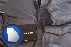 georgia map icon and an leather aviator jacket and pilot log book
