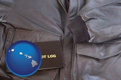 hawaii map icon and an leather aviator jacket and pilot log book