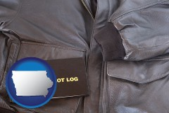 iowa map icon and an leather aviator jacket and pilot log book