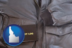 idaho map icon and an leather aviator jacket and pilot log book