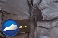 kentucky map icon and an leather aviator jacket and pilot log book