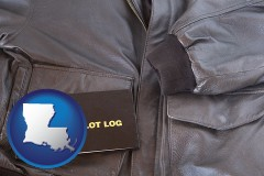 louisiana map icon and an leather aviator jacket and pilot log book