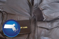 massachusetts map icon and an leather aviator jacket and pilot log book