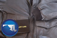 maryland map icon and an leather aviator jacket and pilot log book