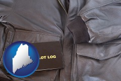 maine map icon and an leather aviator jacket and pilot log book
