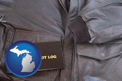 michigan map icon and an leather aviator jacket and pilot log book