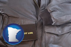 minnesota map icon and an leather aviator jacket and pilot log book