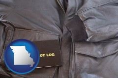 missouri map icon and an leather aviator jacket and pilot log book