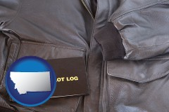 montana map icon and an leather aviator jacket and pilot log book