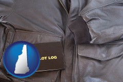 new-hampshire map icon and an leather aviator jacket and pilot log book