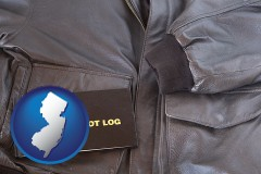 new-jersey an leather aviator jacket and pilot log book