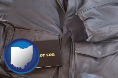 ohio map icon and an leather aviator jacket and pilot log book
