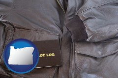 oregon map icon and an leather aviator jacket and pilot log book