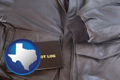 texas map icon and an leather aviator jacket and pilot log book