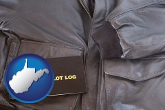 west-virginia map icon and an leather aviator jacket and pilot log book
