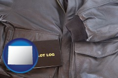 wyoming an leather aviator jacket and pilot log book