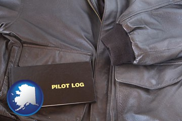an leather aviator jacket and pilot log book - with Alaska icon