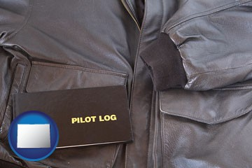 an leather aviator jacket and pilot log book - with Colorado icon