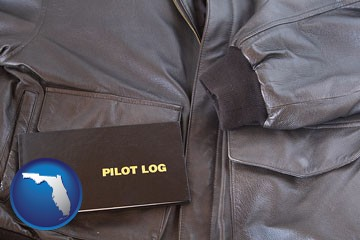 an leather aviator jacket and pilot log book - with Florida icon