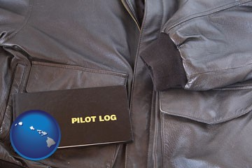 an leather aviator jacket and pilot log book - with Hawaii icon