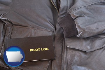 an leather aviator jacket and pilot log book - with Iowa icon