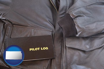 an leather aviator jacket and pilot log book - with Kansas icon