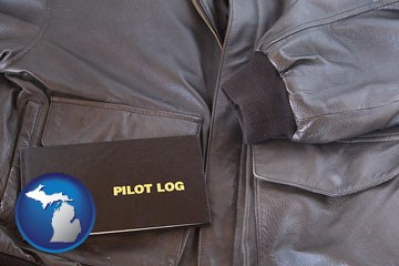 an leather aviator jacket and pilot log book - with Michigan icon