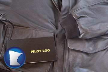 an leather aviator jacket and pilot log book - with Minnesota icon