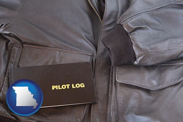 an leather aviator jacket and pilot log book - with Missouri icon