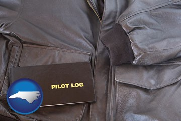 an leather aviator jacket and pilot log book - with North Carolina icon