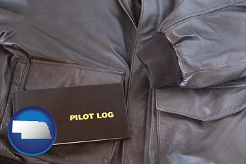 an leather aviator jacket and pilot log book - with Nebraska icon