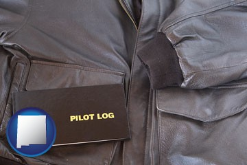 an leather aviator jacket and pilot log book - with New Mexico icon