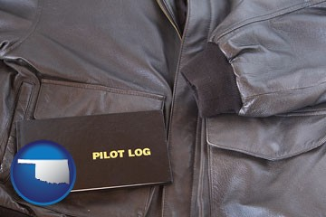an leather aviator jacket and pilot log book - with Oklahoma icon