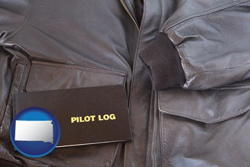 an leather aviator jacket and pilot log book - with South Dakota icon