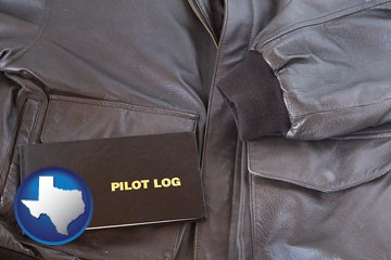 an leather aviator jacket and pilot log book - with Texas icon