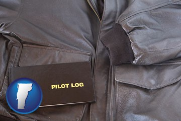 an leather aviator jacket and pilot log book - with Vermont icon