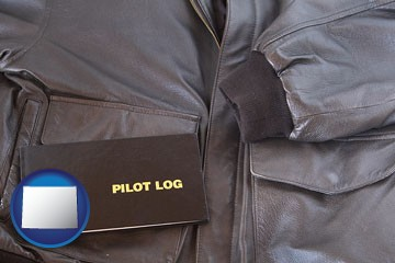 an leather aviator jacket and pilot log book - with Wyoming icon