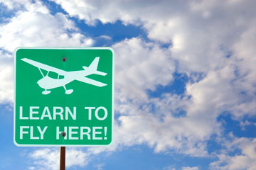 an aviation school sign advertising flying lessons